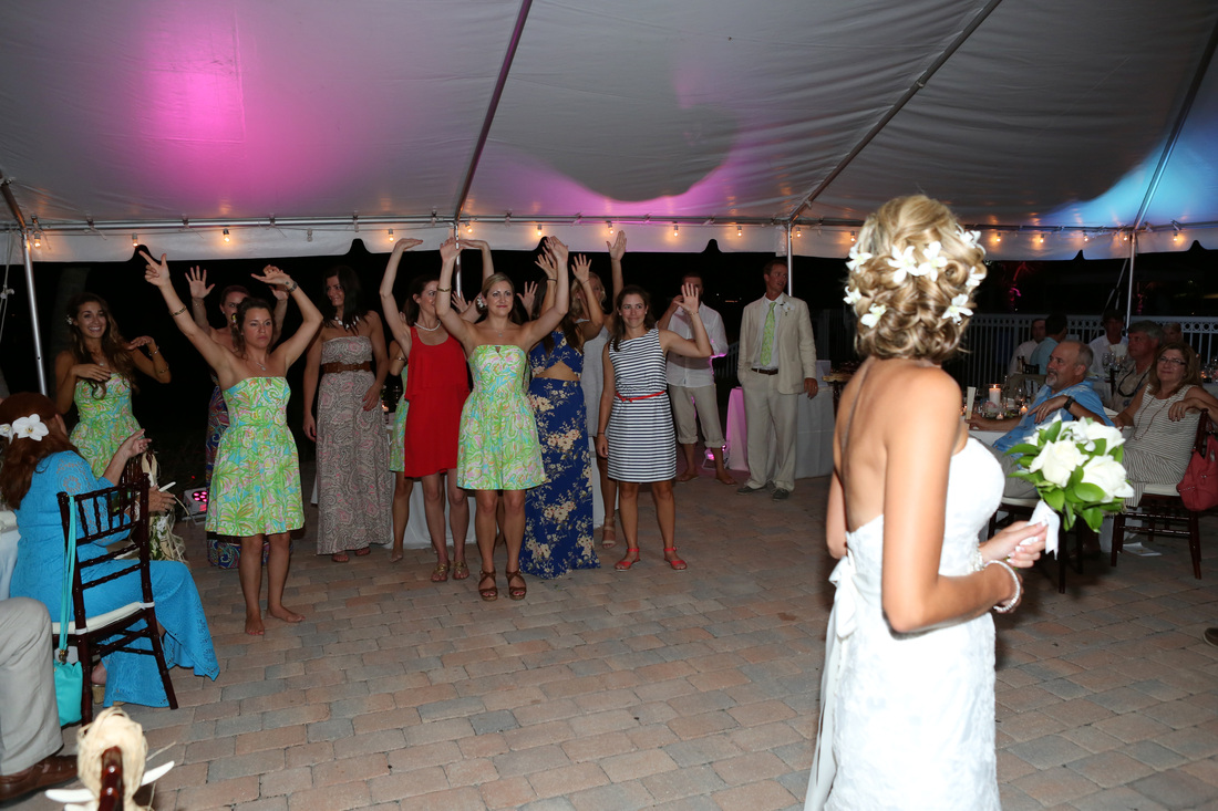 throwing bouquet,bride and groom, first dance, key west wedding photographer, key west wedding photography, wedding photographer in key west, destination wedding photographer, night photography, wedding,