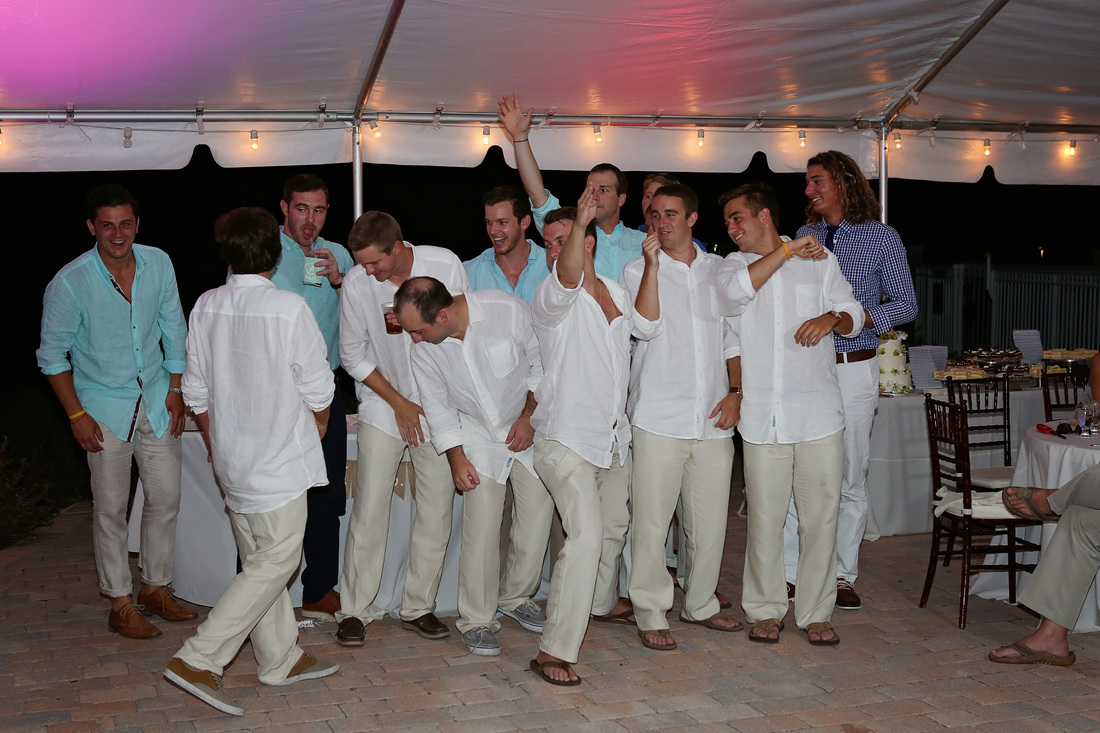 garder throwing, fun wedding, groomsman,bride and groom, first dance, key west wedding photographer, key west wedding photography, wedding photographer in key west, destination wedding photographer, night photography, wedding, yacht club wedding,